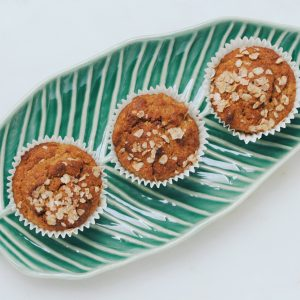three muffins with toppings on ceramic leaf plate